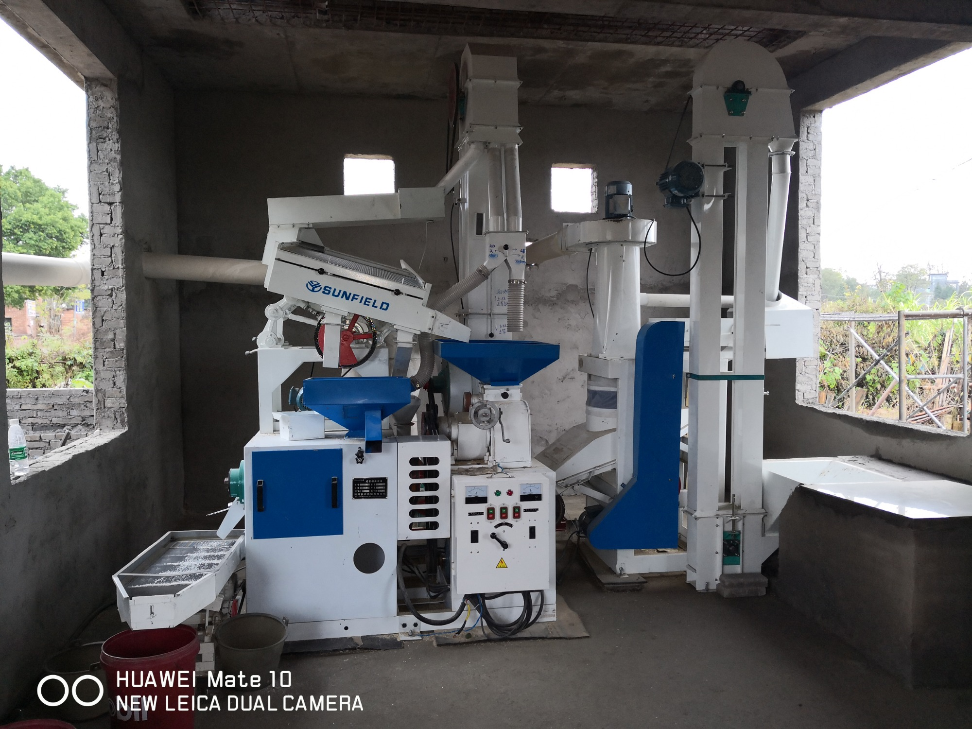Installation case of complete set of 15 tons/day small rice milling machine